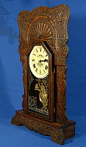 In just a single treatment, Wood Elixir solved numerous problems on this antique clock including removal of mold & mildew, paint smears, water damage, and a dried-out finish